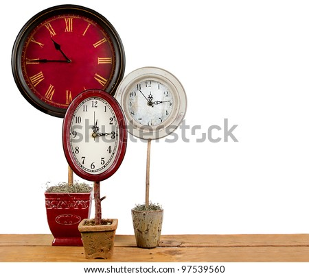 Clocks on a topiary, making more time concept. - stock photo
