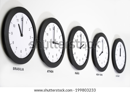 Clocks on wall, symbol for Greenwich Mean Time - stock photo