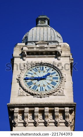Clocktower of Gare de Lyon railway station in Paris in sunny day. - stock photo