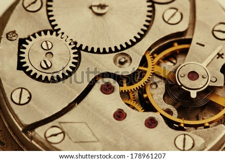 Clockwork details, pinions and wheels closeup - stock photo