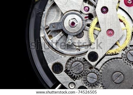 Clockwork macro isolated over the black background - stock photo