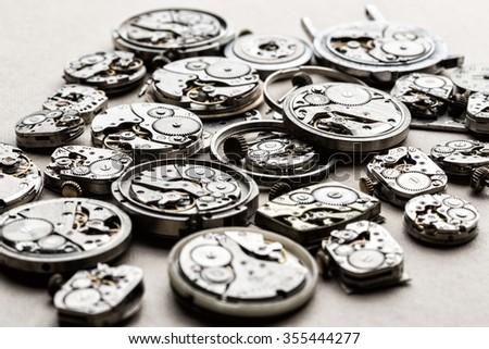 Clockwork spare parts. Metal gear, cogwheels, dial. - stock photo