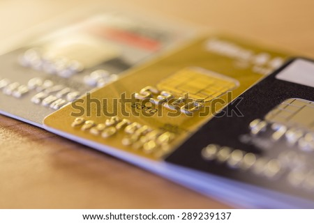 Cloesup view of credit cards in silver, gold and platinum black - stock photo