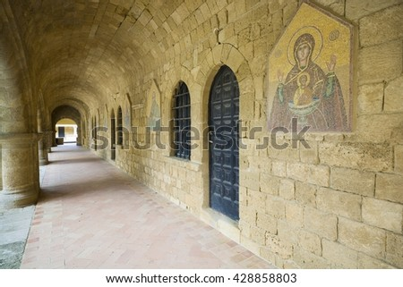 Cloistered and doors to hermits cells in Filerimos Monastery in Rhodes Island built by the Knights of Saint John, Greece - stock photo