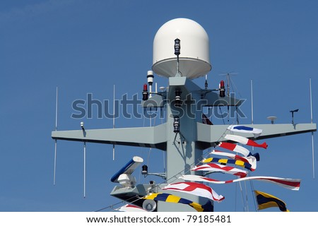 Close details of radar  system and communication tower on a navy patrol frigate - stock photo