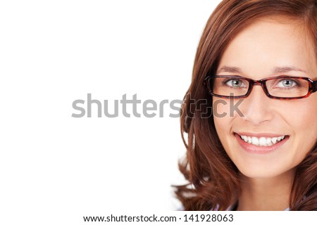 Close face of brunette female with glasses - stock photo