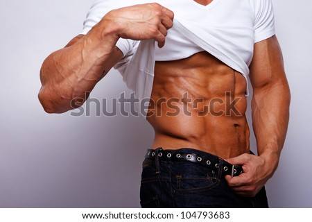 Close image of muscle man torso - stock photo