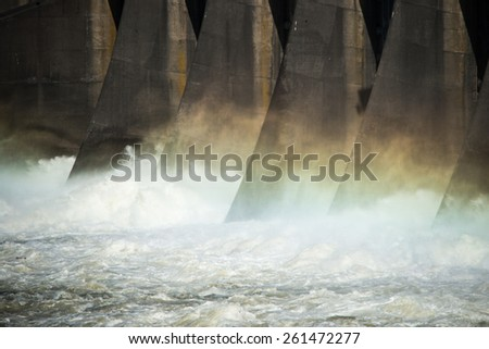 Close in photo of a hydroelectric dam producing clean renewable energy. - stock photo