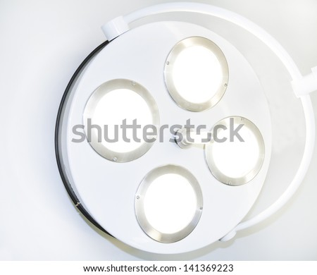 Close of an illuminated operating theatre light - stock photo