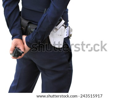 Close of of policeman's hand on his transmitter. Security agent surveillance guard - stock photo