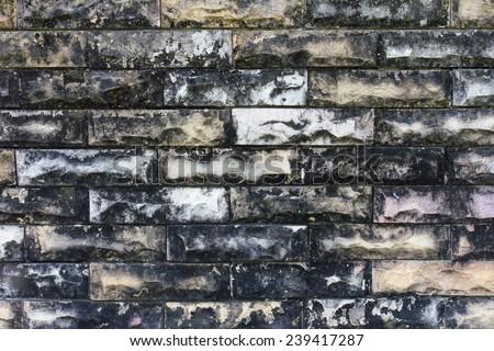 Close-old yellow brick wall weathered patina black and white. - stock photo
