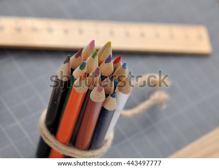 close on colored pencils with wooden rule on a slate  - stock photo