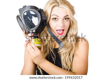 Close photo on the face of a woman in fear holding gas mask in white background warfare. Terror alert - stock photo