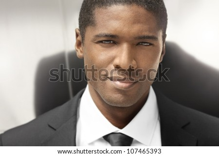Close portrait of a nice young businessman - stock photo
