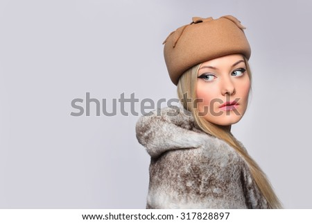 close portrait of beautiful blond woman in retro vintage style, hat and fur. copy space. - stock photo