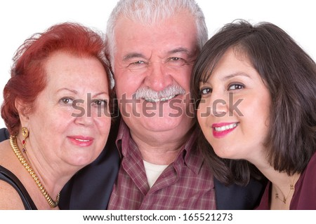 Close portrait of senior couple and their middle age daughter all three of them showing their happiness perhaps its fathers day - stock photo