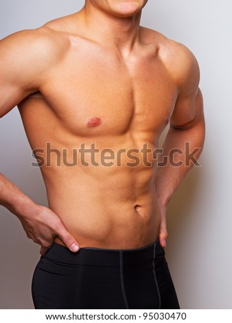 Close portrait of sportsman in sport wear - stock photo