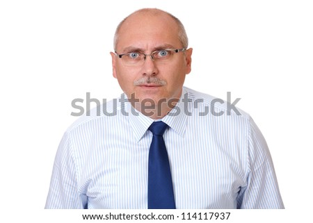 Close portrait of surprised senior businessman in blue shirt looking through glasses, isolated on white - stock photo