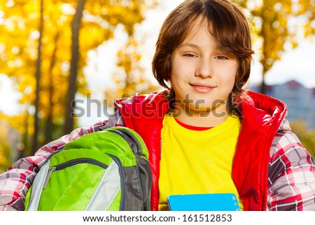 Close portrait of 12 years old boy after school - stock photo