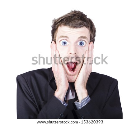 Close portrait on the face of a funny man with crazy surprised look holding head in amazement over white background. Eye popping and jaw dropping concept - stock photo