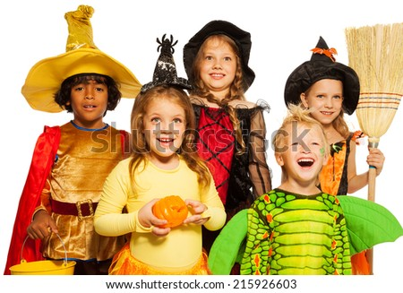 Close shoot of five kids in Halloween costumes - stock photo