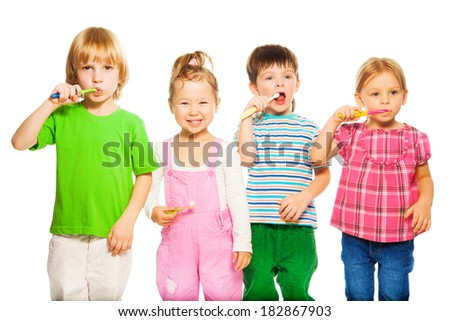 Close shoot of four happy little 3-4 years old kids standing with toothpaste - stock photo
