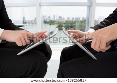 Close-shot of human hands touching their pads - stock photo