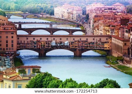 Close shot of Ponte Vecchio over Arno river in Florence - stock photo
