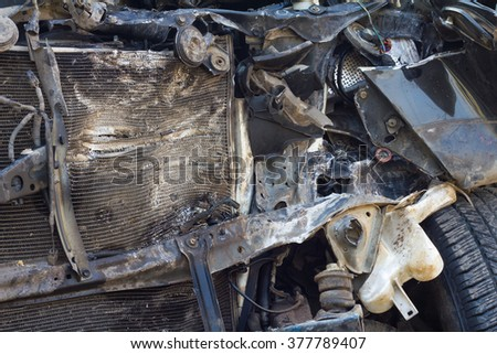Close the front car, which was completely destroyed by the accident collided with another vehicle. - stock photo