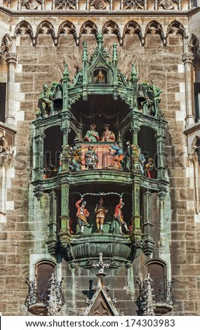 Close to the big old chimes of the town hall in Munich in Bavaria - stock photo