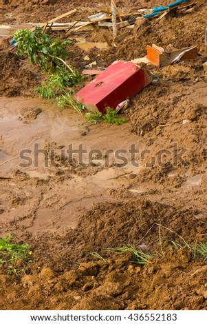 Close to the river, soil erosion, land slide with ruins and debris. - stock photo