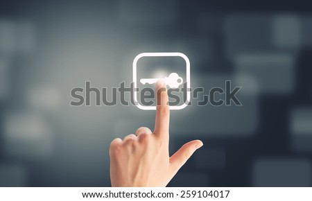Close u of human hand pushing application icon - stock photo