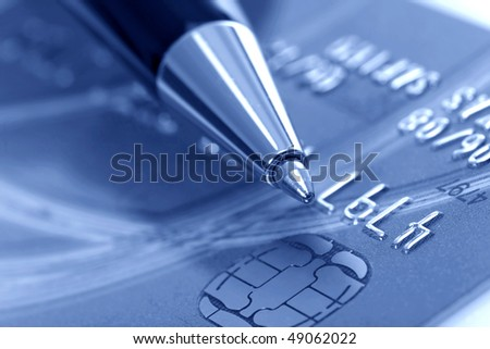 Close up a credit card and pen - stock photo