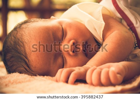 Close up a little baby is sleeping sweet dream. Asian baby.Vintage  or retro tone. - stock photo