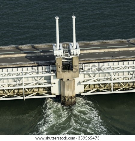 Close up aerial view of the Oosterscheldekering, a storm surge barrier which is part of the delta works to protect Holland from high sea level - stock photo