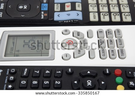 Close up air conditioner remote control on TV remote background - stock photo