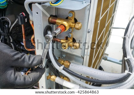Close up air conditioner service and shut off valve - stock photo