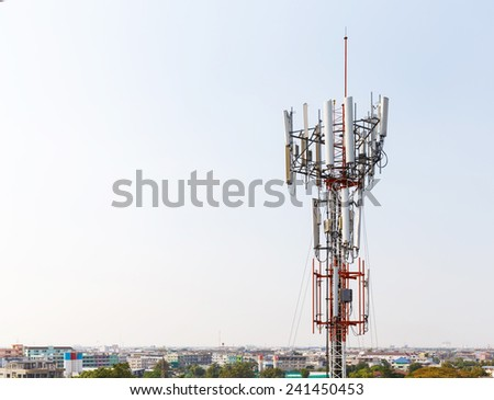 Close up antenna repeater cell tower in city - stock photo