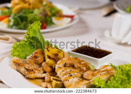 Close up Appetizing Garnished Juicy Chicken Meat Dish with Hot Dipping Sauce For Perfect Taste Served on the Table at the Restaurant. - stock photo