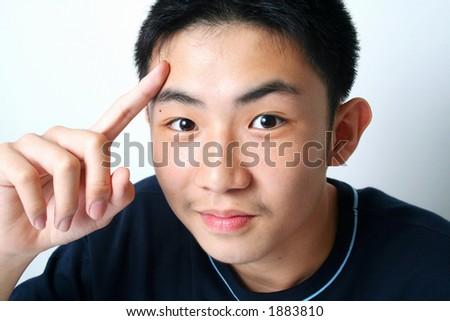 Close-up asian guy - stock photo
