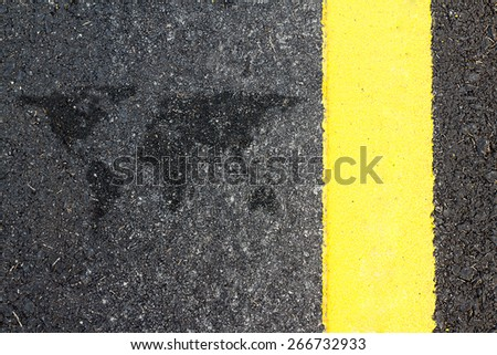 close-up asphalt road with yellow lines map blurred world - stock photo