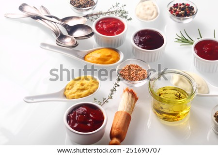 Close up Assorted Fresh Condiments on White background with Herbs - stock photo