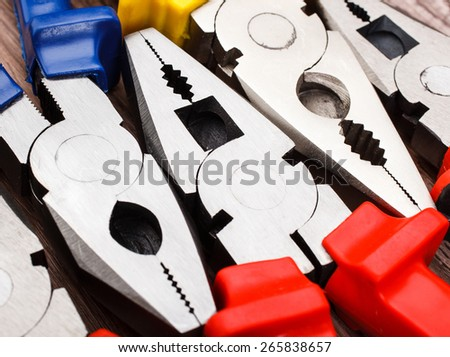 Close up Assorted Hand Work Tool Pliers background - stock photo
