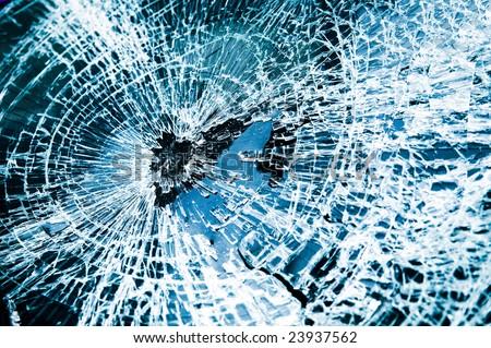 Close-up at broken car windshield. Tint blue - stock photo