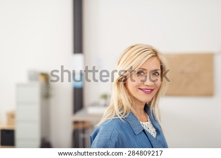 Close up Attractive Blond Businesswoman Inside the Office, Smiling at the Camera. - stock photo