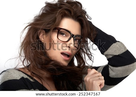 Close up attractive woman face with casual hairstyle, wearing fashion eyeglasses while looking at camera. Isolated on White Background. Cool trendy eyewear portrait isolated on white background - stock photo