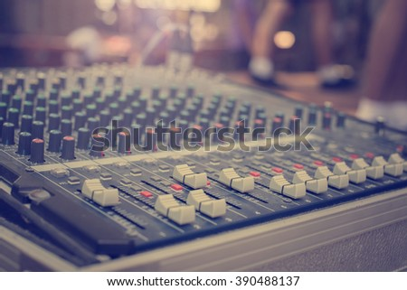 close up audio mixing console and faders on soft focus of faders and def of field effect,vintage tone - stock photo