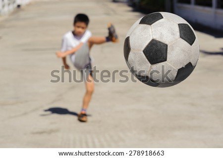 Close up Ball fly from the boy kick  - stock photo