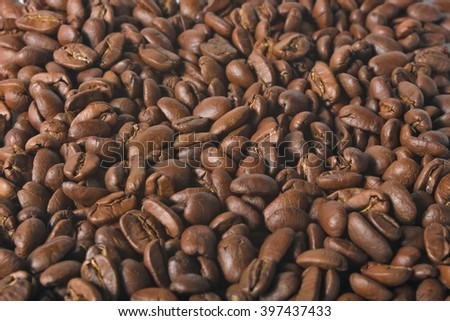 Close up beans on a white background. Coffee on the entire screen for the background. Roasted coffee beans brown. Lots of coffee in high definition. - stock photo