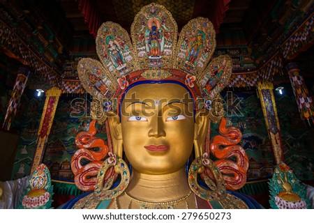 Close up beautiful sculpture of The Maitreya Buddha at Thiksey Monastery in Leh Ladakh - stock photo